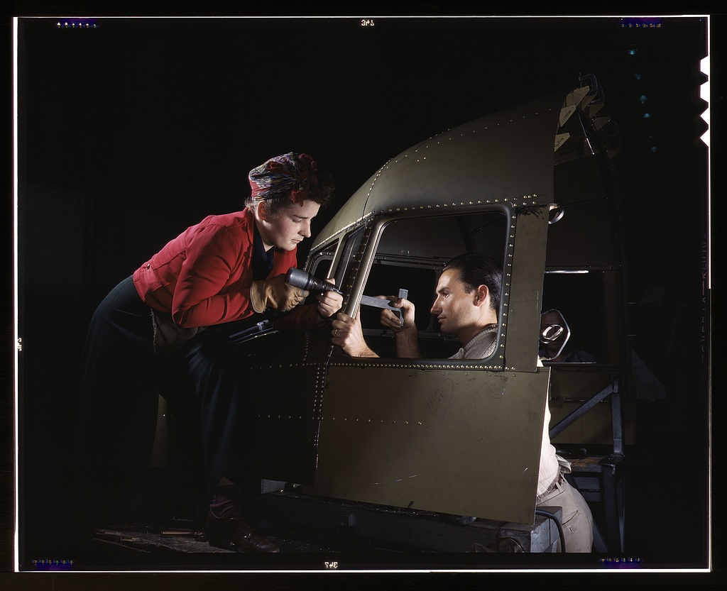 Riveting team working on the cockpit shell of a C-47, Long Beach Factory